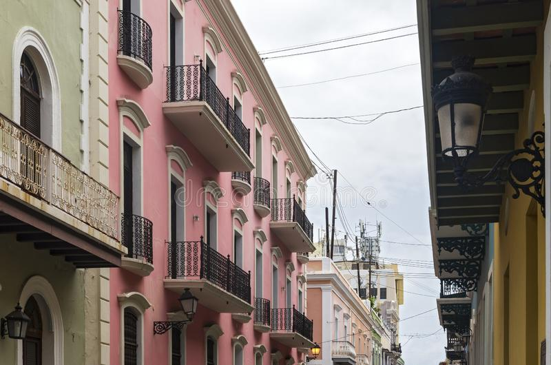 Facades and Balconies Line Streets of Old San Juan. Colorful building facades and balconies line streets of old san juan puerto rico stock photo