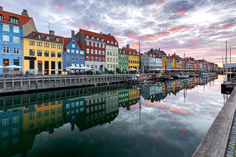 Copenhagen. Nyhavn Canal, colorful houses and city embankment at sunrise. The facades of the famous colorful houses along the Nyhavn canal. Copenhagen. Denmark royalty free stock photo