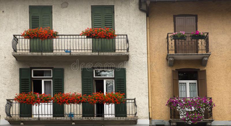 Facades with flowers, Cortina dAmpezzo, Italy stock photo