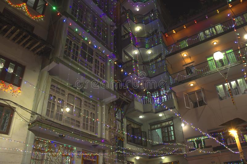 Facades of high-rise buildings are decorated with luminous colored garlands on Diwali festival at night. The facades of high-rise buildings are decorated with stock photo