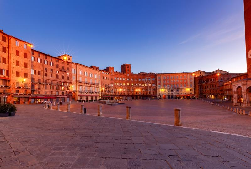 Siena. The central city square piazza del Campo. Facades of medieval buildings on Piazza del Campo at night. Siena. Tuscany. Italy royalty free stock photo