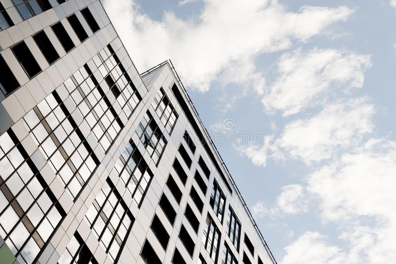 Facades of new buildings, construction of apartment buildings, residential real estate in the big city. stock photo