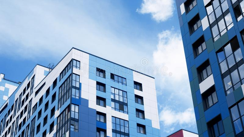 Facades of new buildings, construction of apartment buildings, residential real estate in the big city. Development stock images