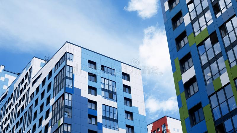 Facades of new buildings, construction of apartment buildings, residential real estate in the big city. Development stock photo