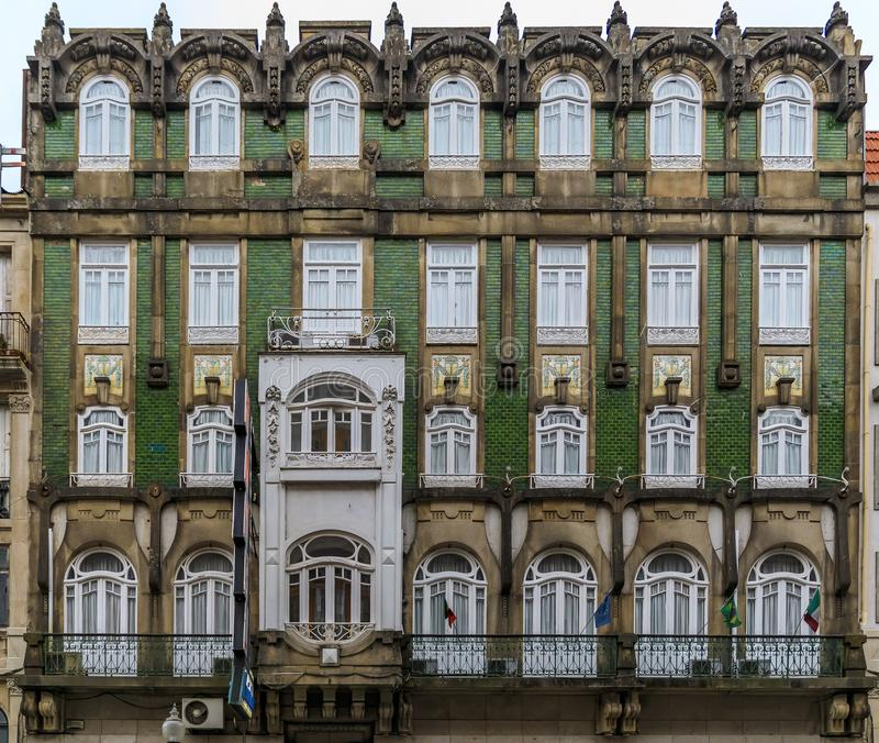 Facades of traditional houses decorated with ornate Portuguese azulejo tiles in Porto, Portugal royalty free stock photo