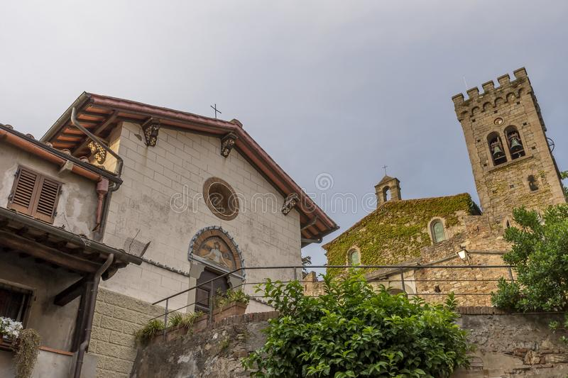 The facades of the two churches of the Santissimo Crocifisso and San Lorenzo in the upper part of Castagneto Carducci, Italy. The facades of the two churches of stock images