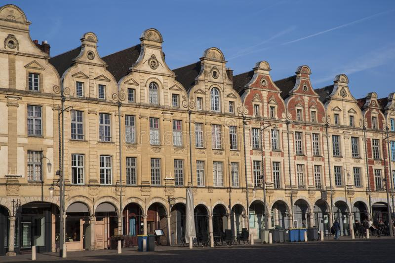 Place of Arras in France with typical houses. Facades of typical Flemish medieval houses in a square of Arras in France stock photos