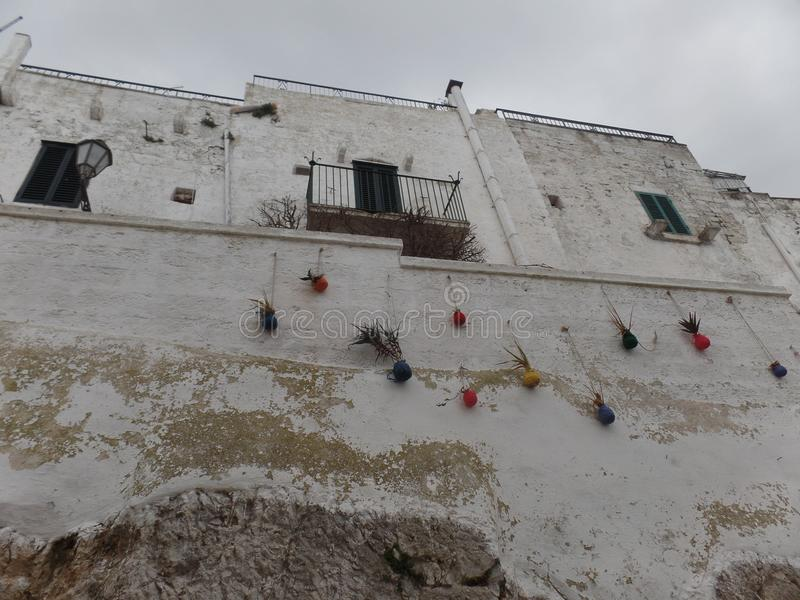 Facades of whitewashed buildings in Ostuni, Puglia, Southern Italy royalty free stock image