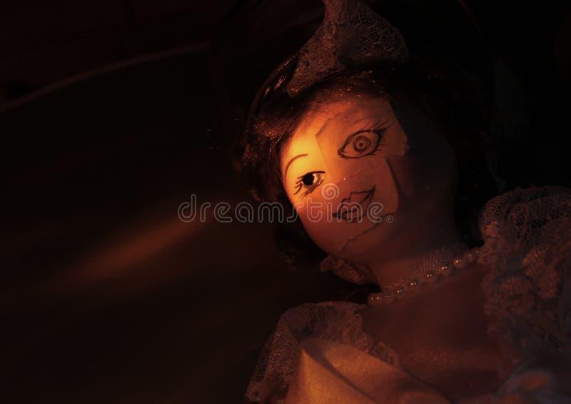 Faccia della bambola di terrore immagini stock