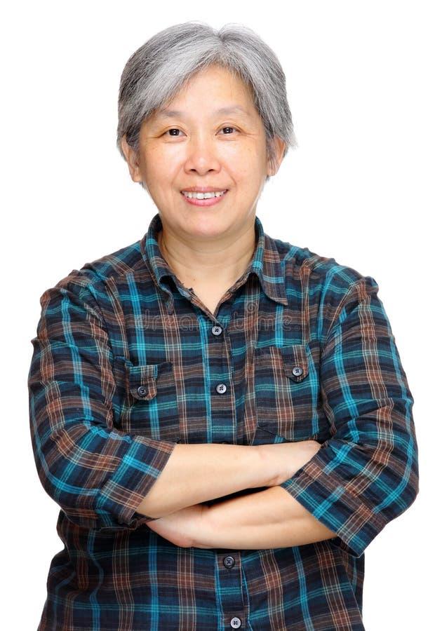 Faccia maturare il sorriso asiatico della donna fotografie stock