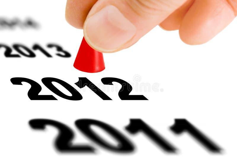 Faccia un passo nel nuovo anno 2012 immagini stock