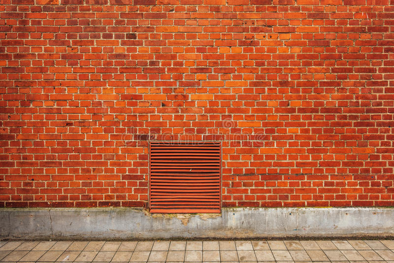 Facciata della costruzione del muro di mattoni, contesto urbano della via fotografia stock libera da diritti