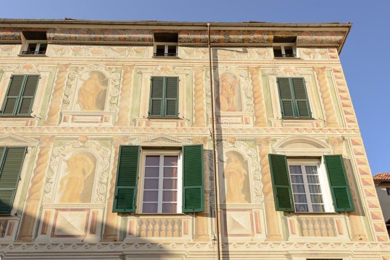 Facciata dipinta tradizionale, campo Ligure, Italia fotografia stock