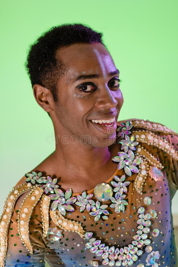 Face of african american man wearing costume. Colorful background. Carnival concept, funny and party. Carnaval Brazil stock photos