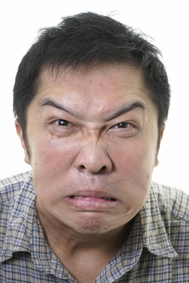 Face asiática distorcida irritada fotografia de stock