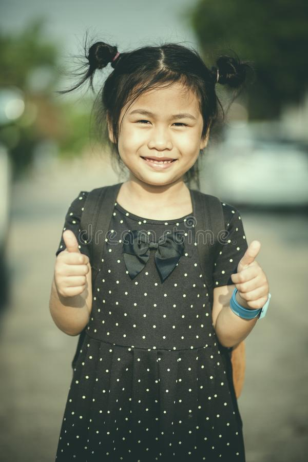 Face of asian children smiling face and sign good feeling by fin royalty free stock photography