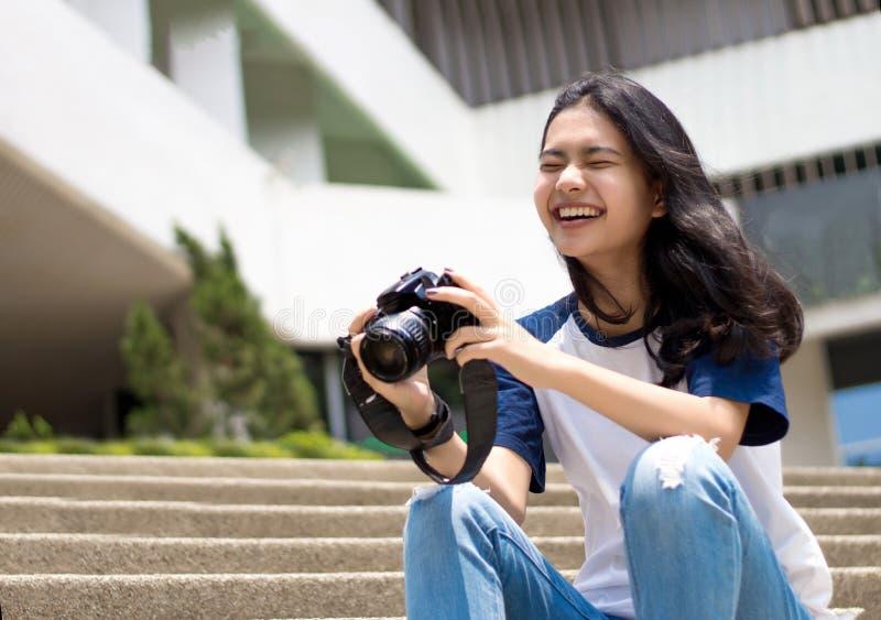 Face of asian teenage like to take photo stock image