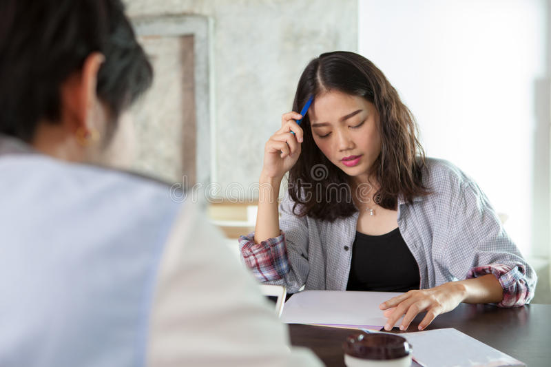 Face of asian younger woman seriously thinking in family problem royalty free stock images