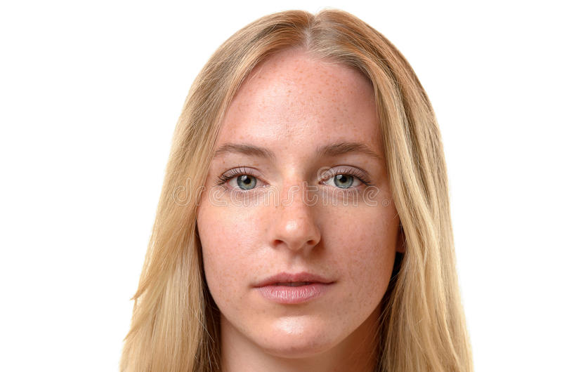 Face of an attractive serious blond woman stock images