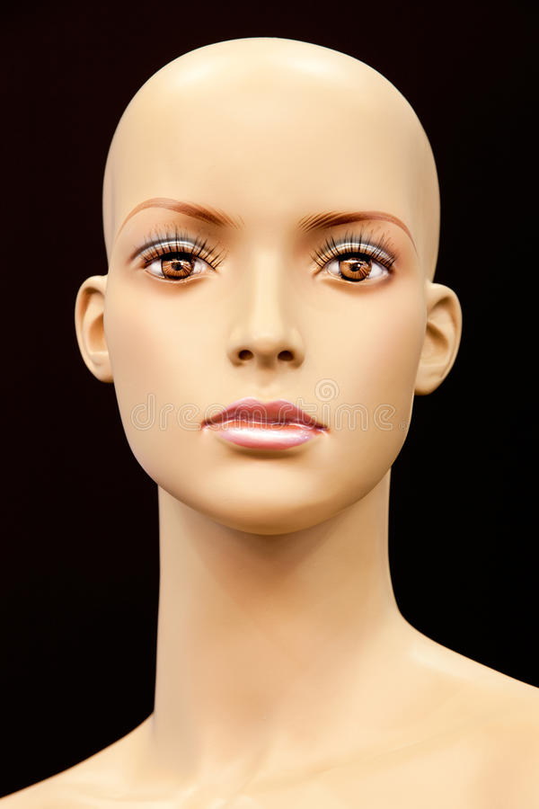 Face of a bald mannequin stock images