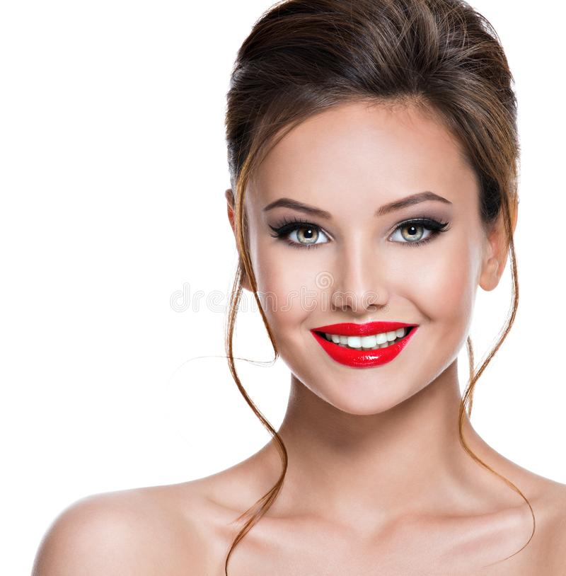 Face of beautiful expressive woman with red lipstick on the lips royalty free stock photo