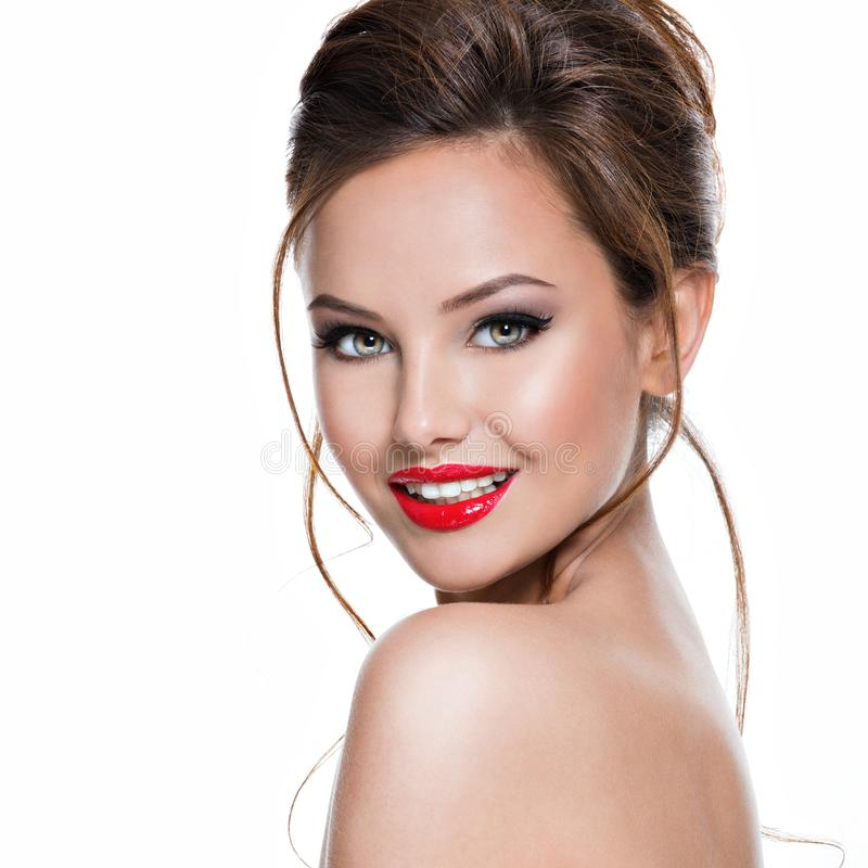 Face of beautiful expressive woman with red lipstick on the lips stock images