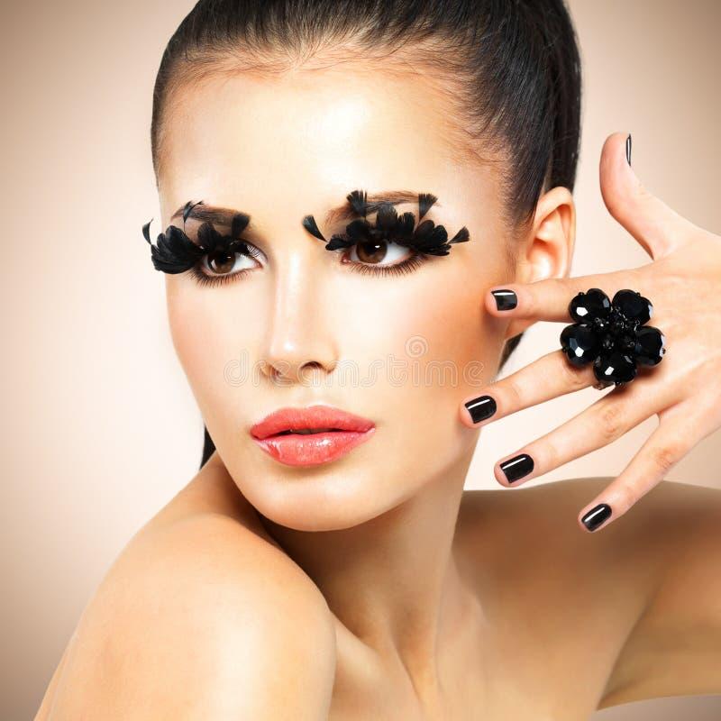 Face of beautiful fashion woman with black false eyelashes royalty free stock image