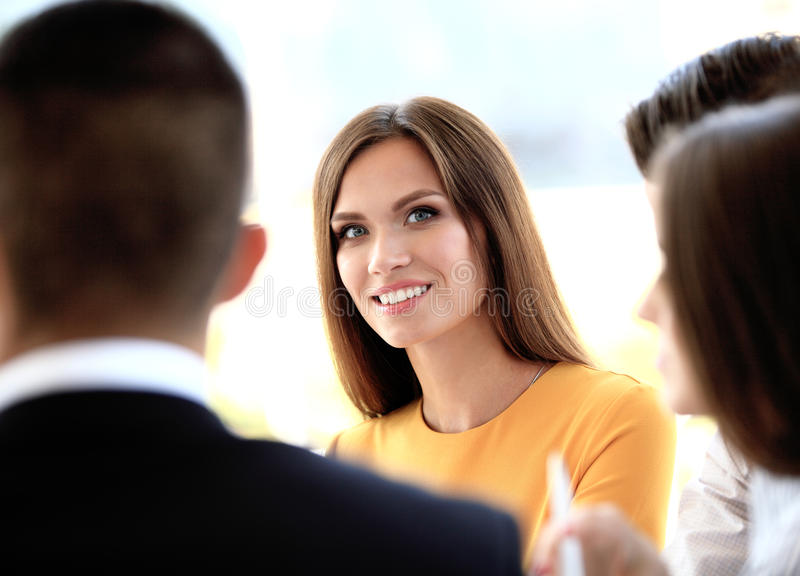 Face of beautiful woman on background of business people. Face of beautiful women on the background of business people royalty free stock images