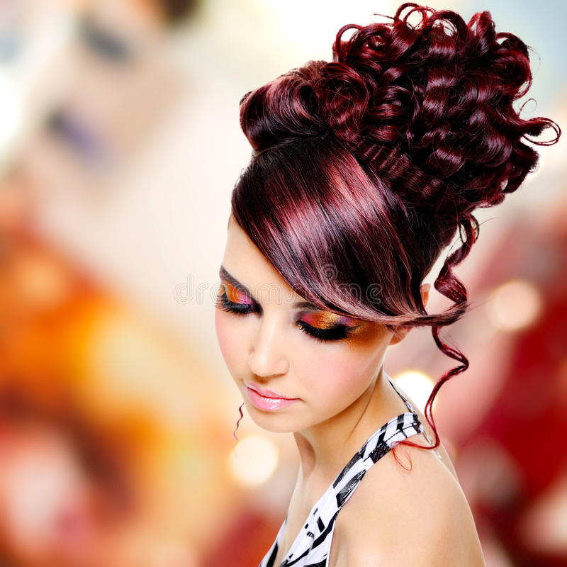 Face of beautiful woman with fashion hairstyle and glamour makeup. Over creative soft bokeh background stock image