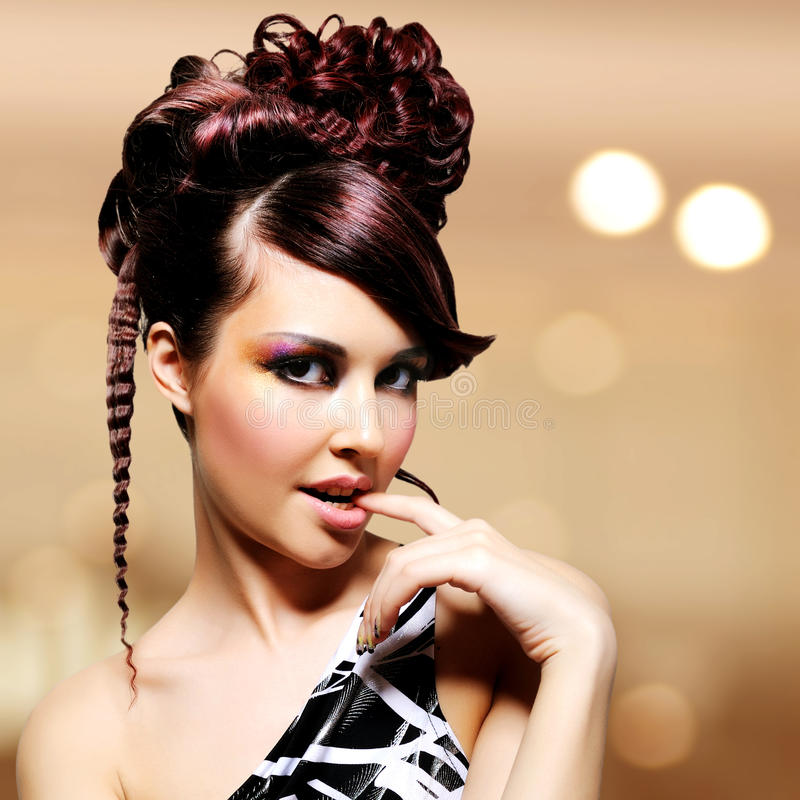 Face of beautiful woman with fashion hairstyle and glamour makeup stock images