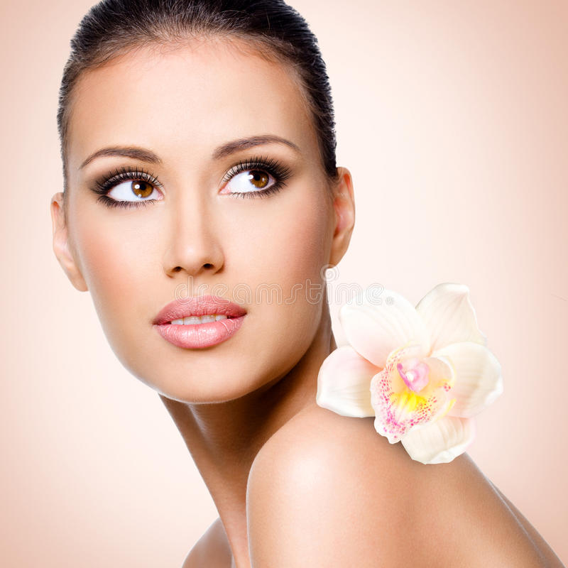 Download Face Of Beautiful Woman With A  Flower Stock Image - Image: 36603261