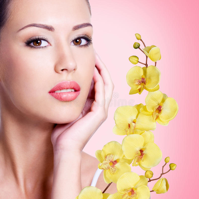 Download Face Of Beautiful Woman With A  Flower Stock Image - Image of care, wellness: 36603273
