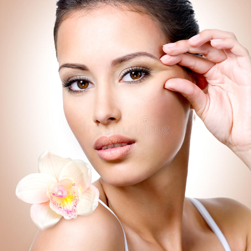 Download Face Of Beautiful Woman With A  Flower Stock Photo - Image: 36603282