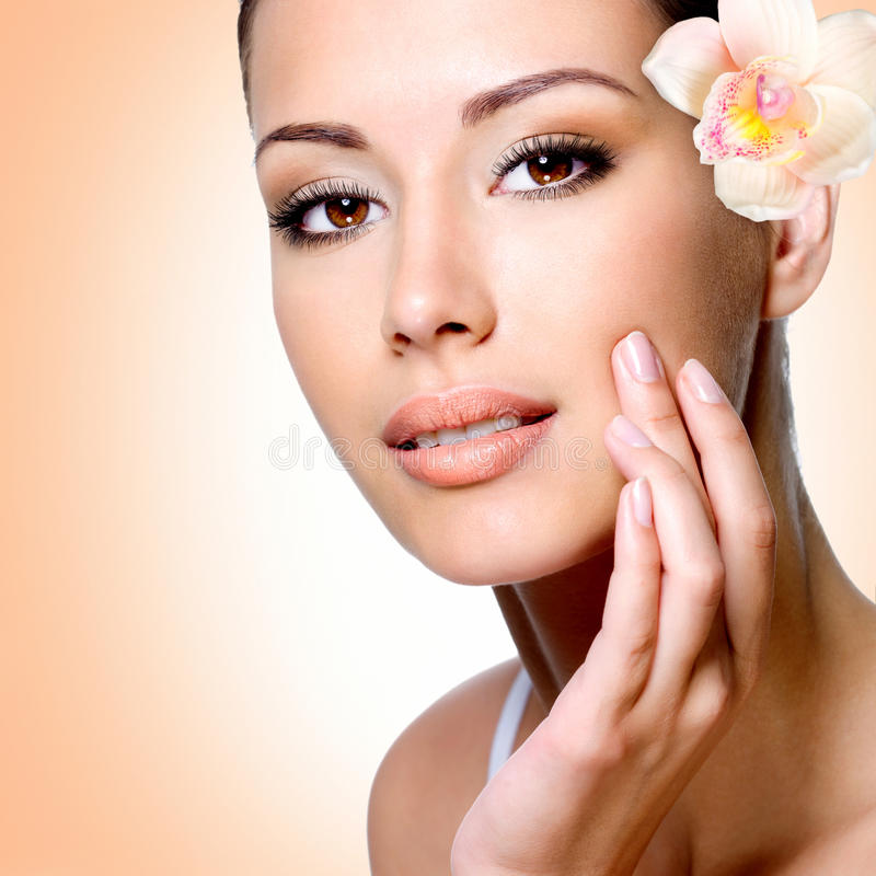 Face of beautiful woman with a flower stock photography