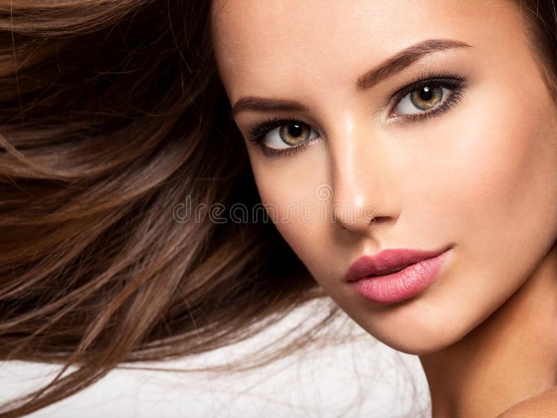 Beautiful woman with long brown hair royalty free stock image