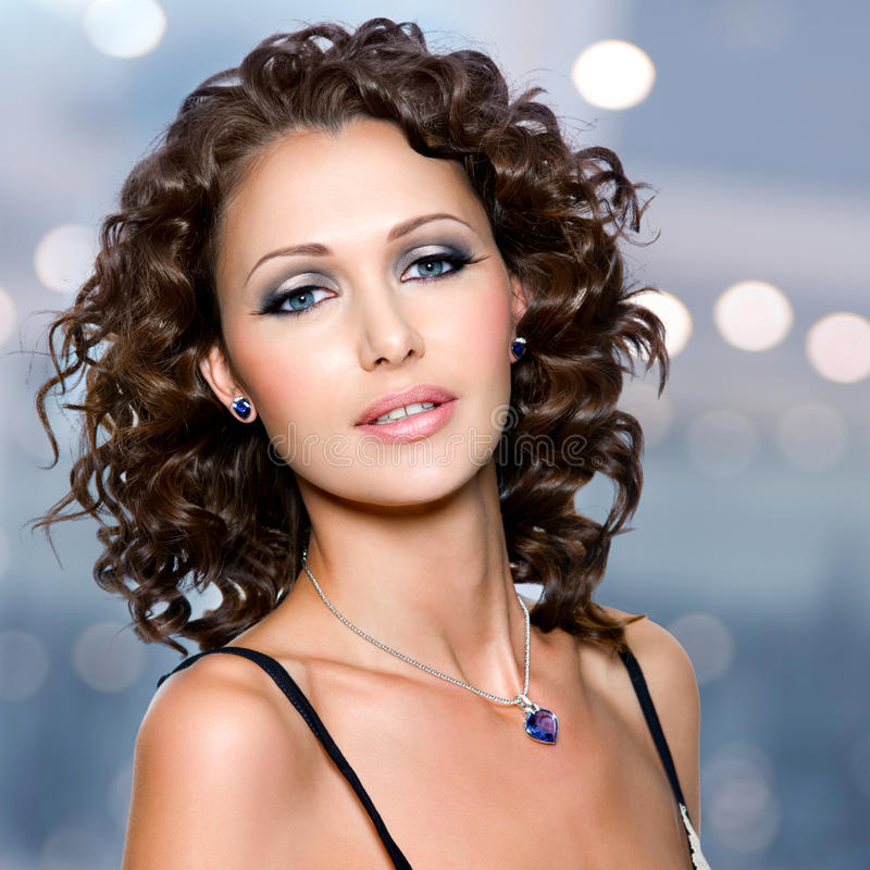 Face of beautiful woman with long curly hairs stock photos