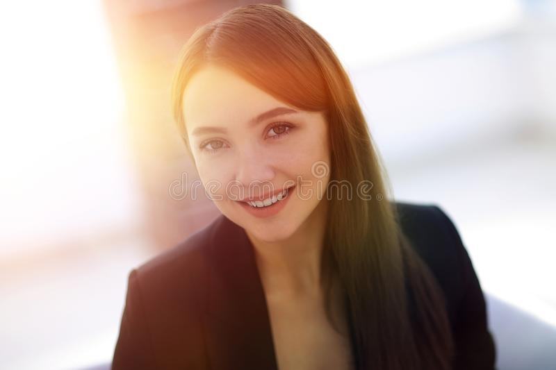 Close up portrait of young business woman in modern office stock photos