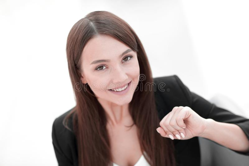 Close up portrait of young business woman in modern office. Face of beautiful woman on office background royalty free stock images