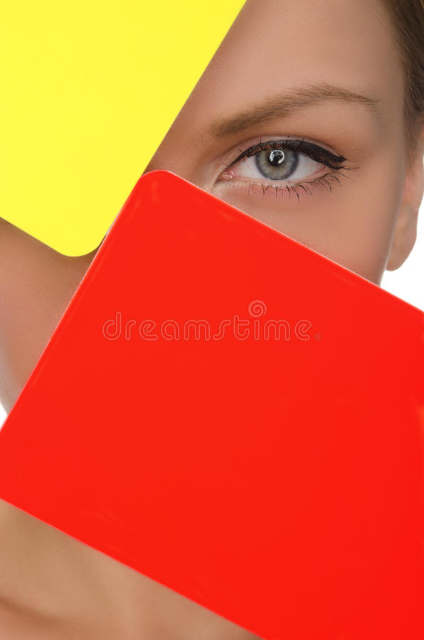 Face of beautiful woman with red and yellow soccer card royalty free stock photography