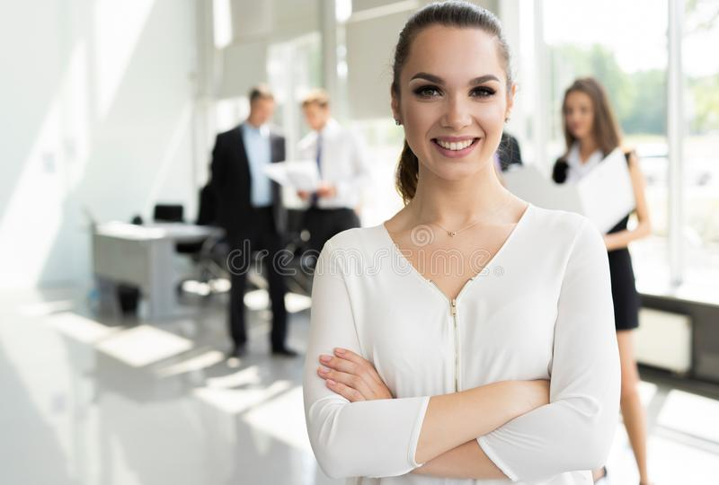 Face of beautiful woman on the background of business people. Face of beautiful women on the background of business people royalty free stock image
