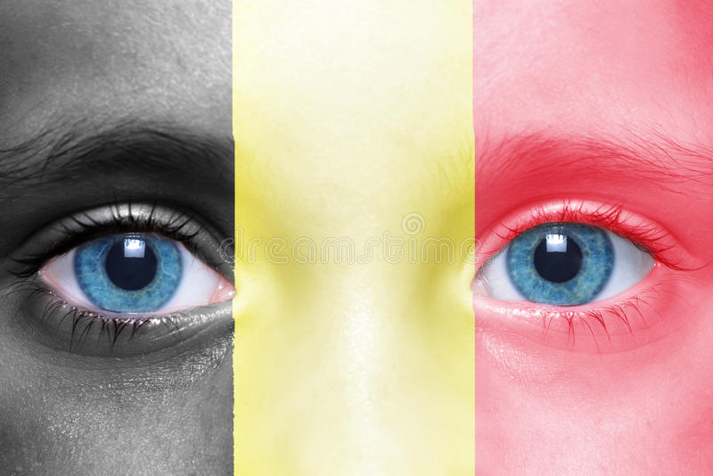 Face with belgian flag. Child`s face with belgian flag stock photos
