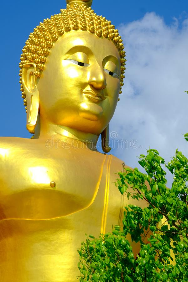 Face of Big golden Buddha with blue sky at Wat muang,Angthong,Thailand royalty free stock images