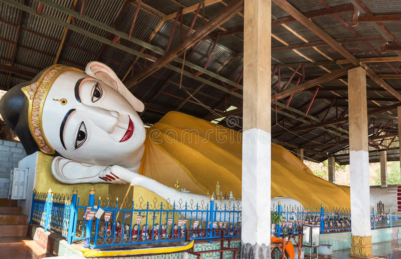 Face of big white reclining Buddha red lip statue in myanmar temple royalty free stock images