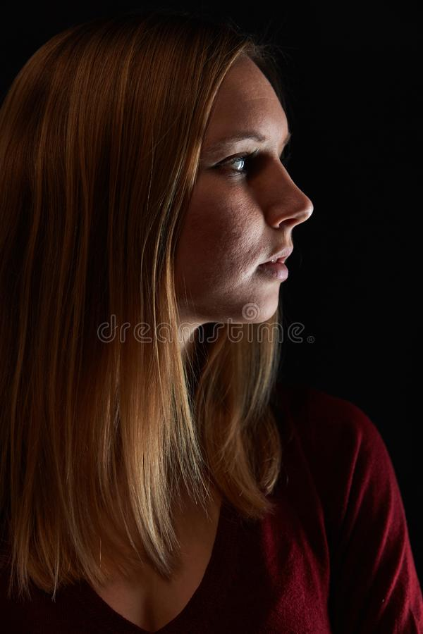 Face of a blond woman in profile stock photography