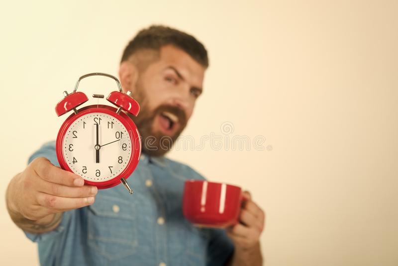 Face boy for magazine cover. Man face portrait in your advertisnent Red alarm and mug, perfect morning, copy space stock image