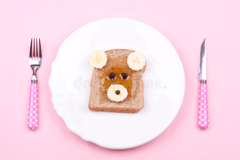 Face on bread for breakfast royalty free stock image