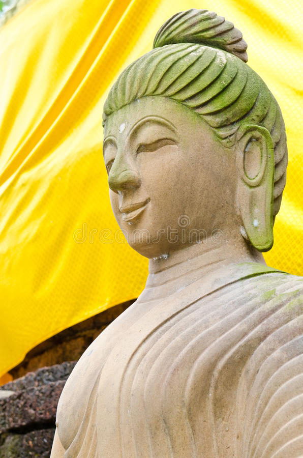 Face of brown buddha statue. At Wat Pasawangboon temple, Thailand royalty free stock images