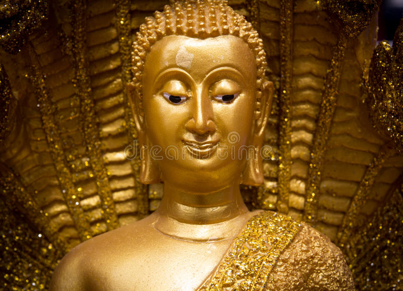 Face buddha status. Golden face of buddha status stock images