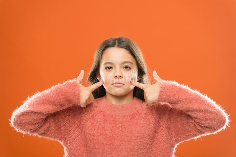 Face building exercises. Forever young. Girl cute kid elastic skin show exercises for facial muscles. Beauty treatment royalty free stock image