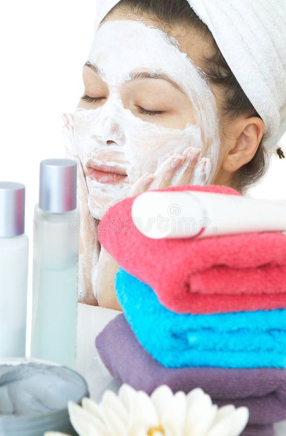 Face care. Skin care massage with shallow dof, on white stock photos